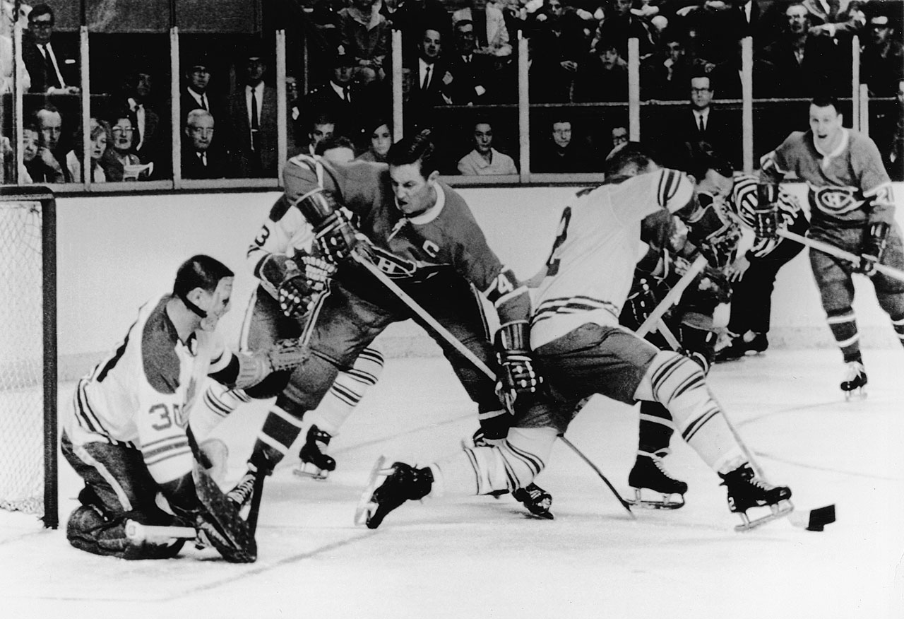 Jean Beliveau (center) and the Canadiens thrashed netminder Terry Sawchuk in Games 1 and 4 by identical 6-2 scores, but the wily veteran would have his revenge. The Hall of Famer stopped 77 of the final 79 shots he faced in the series, leading Toronto to a 4-1 win in Game 5 (pictured) and 3-1 triumph in the Game 6 clincher. The Maple Leafs have not won the Cup since.