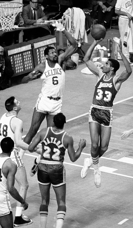 Bill Russell leaps to block a shot from Glen Hawkins in the second game of the 1968 Finals. After recovering from a three-games-to-one deficit against the 76ers in the Eastern Conference finals, the Celtics beat the Lakers in six games for Russell's 10th title in 12 seasons.