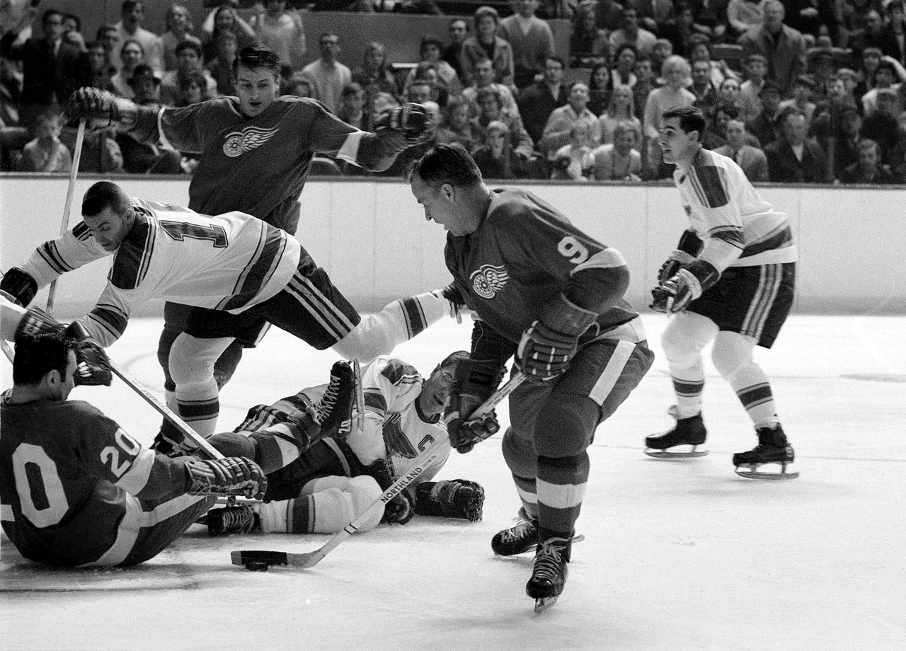 Gordie Howe looks to score around all of the clutter in front of the goal during the Detroit Red Wings game against the St. Louis Blues at Olympia Stadium in Detroit.