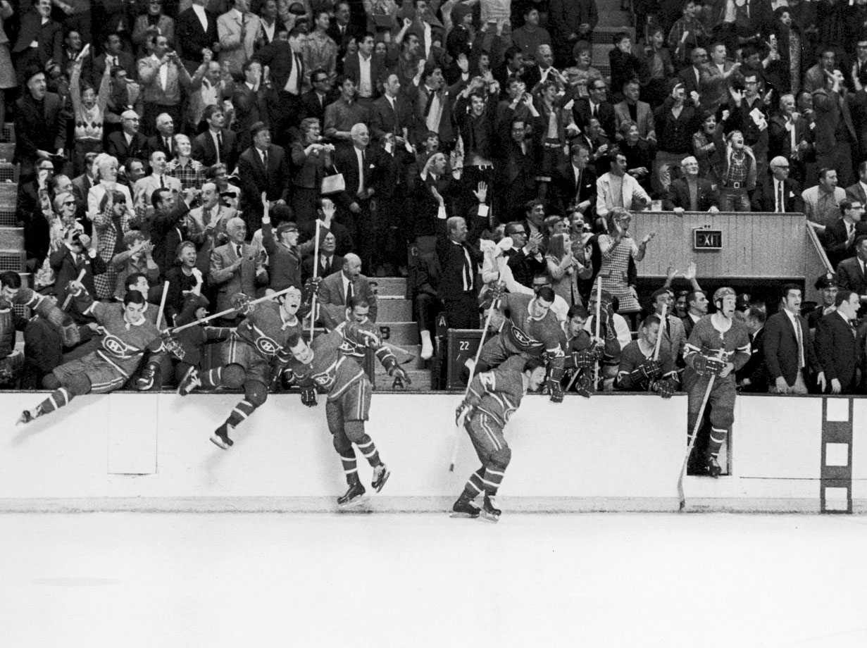 Bobby Rosseau, Dick Duff, Jacques Laperriere, Yvan Cournoyer, and Danny Grant (left to right) led a parade of jubilant Canadiens over the boards after Montreal swept the expansion St. Louis Blues. The victory marked the eighth and final Cup for legendary Canadiens coach Toe Blake.