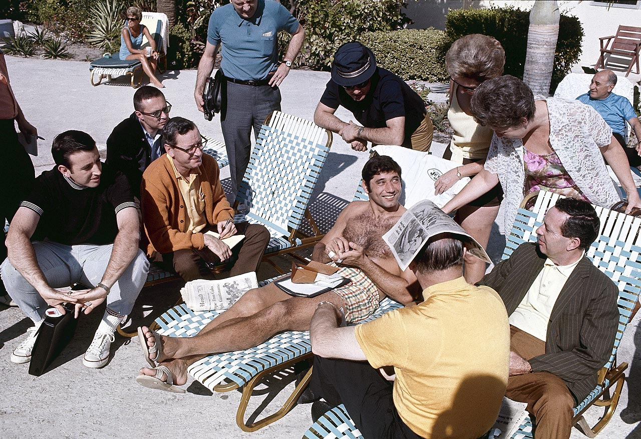 A relaxed Joe Namath chats poolside with the media before his big matchup with the Baltimore Colts. The quarterback made headlines when he guaranteed a Jets win, despite the AFL's 0-2 record in the first two Super Bowls.