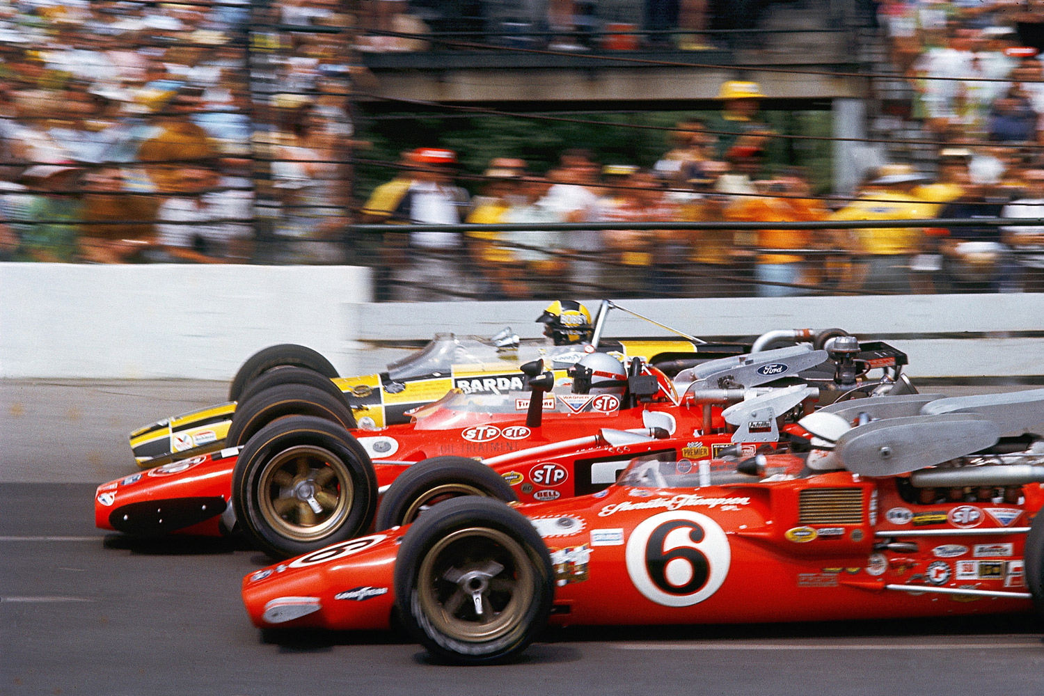 Although he was flanked by past winners Bobby Unser and A.J. Foyt (6) at the start of the race, Mario Andretti prevailed to take his first and only checkered flag.