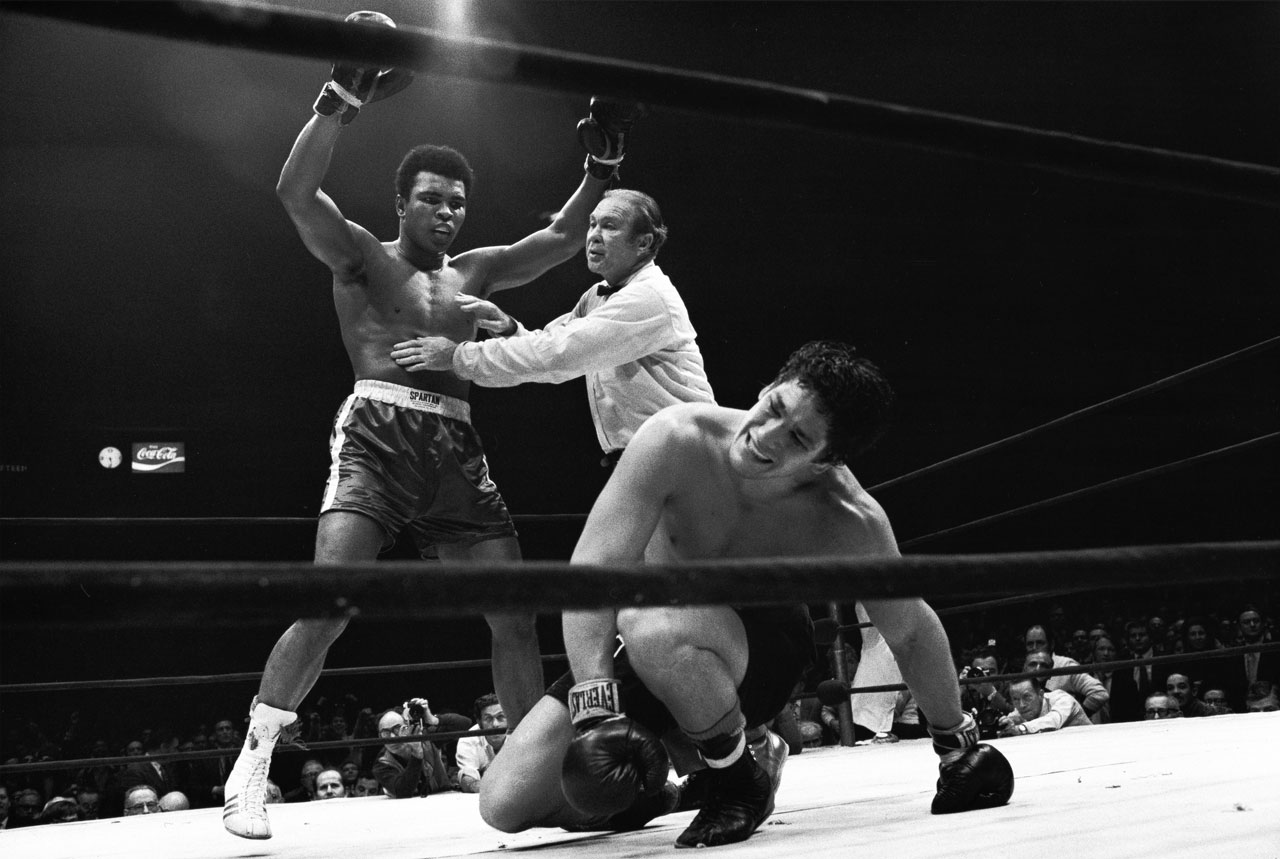 After a long, often sloppy bout, Ali — here being held back by referee Mark Conn — produced one of the most dramatic finishes of his career, dropping Bonavena three times in the 15th and final round to automatically end the fight. The win cleared the way for a showdown with Joe Frazier, the man who had taken the heavyweight title in Ali's absence.