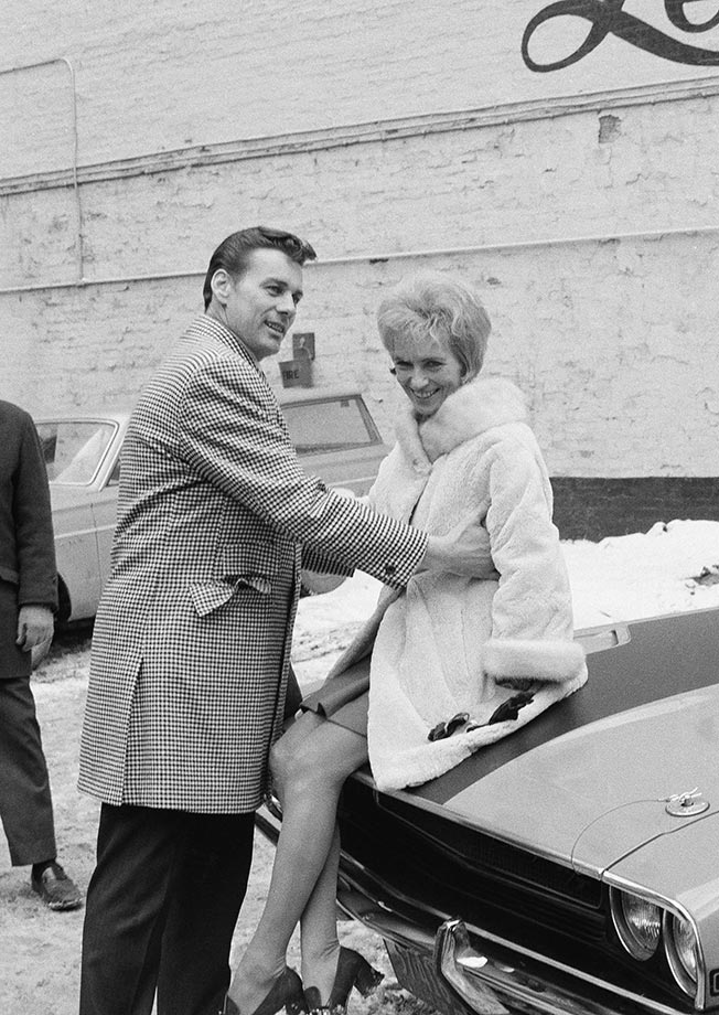Quarterback Len Dawson of the champion Kansas City Chiefs boosts his wife, Jackie, onto the hood of his new car in New York, Jan. 13, 1970. The car was part of his reward for being named most valuable player in the Super Bowl game with Minnesota .