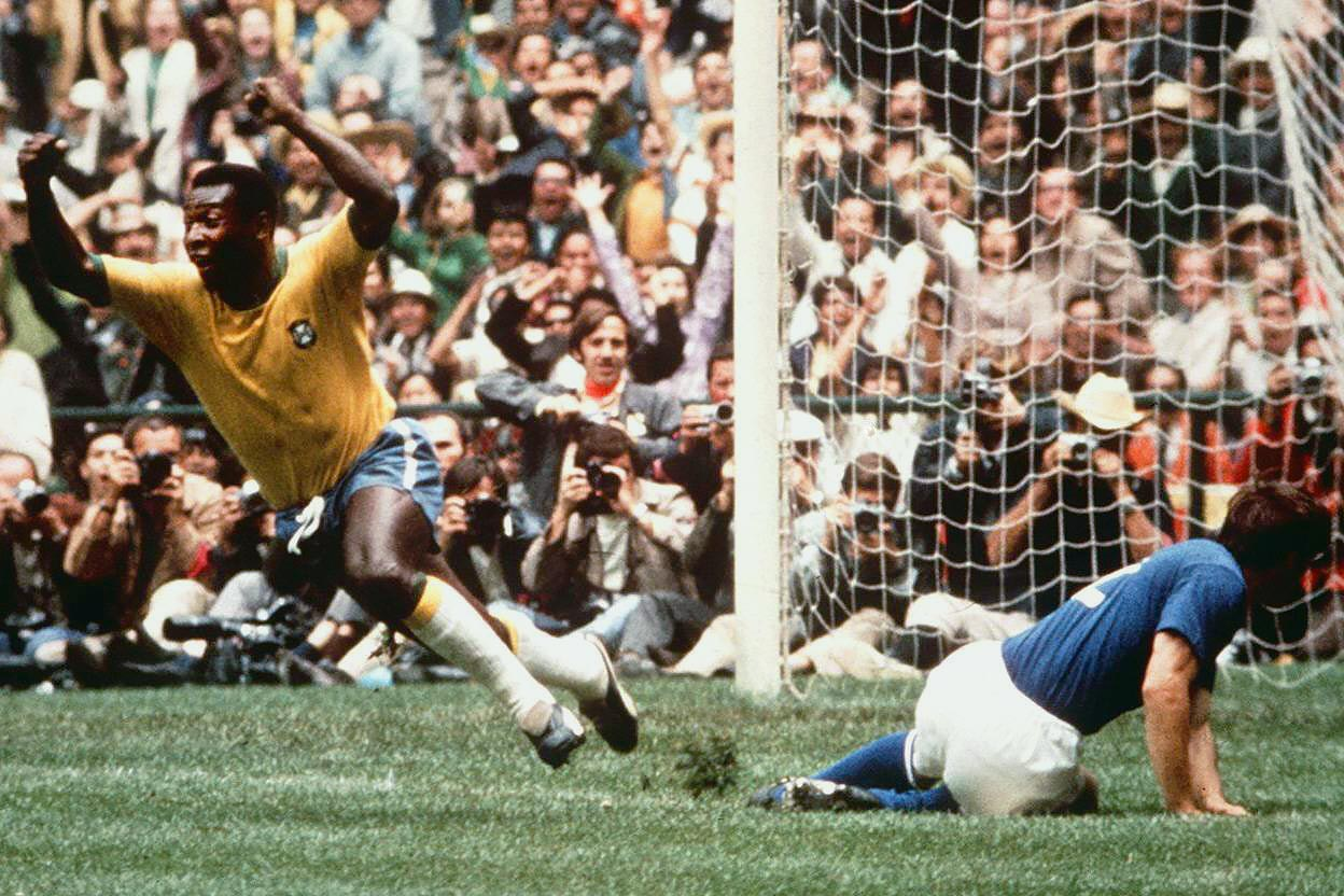 An elated Pelé sprints to his teammates in celebration after knocking in the first goal of the 1970 World Cup final.