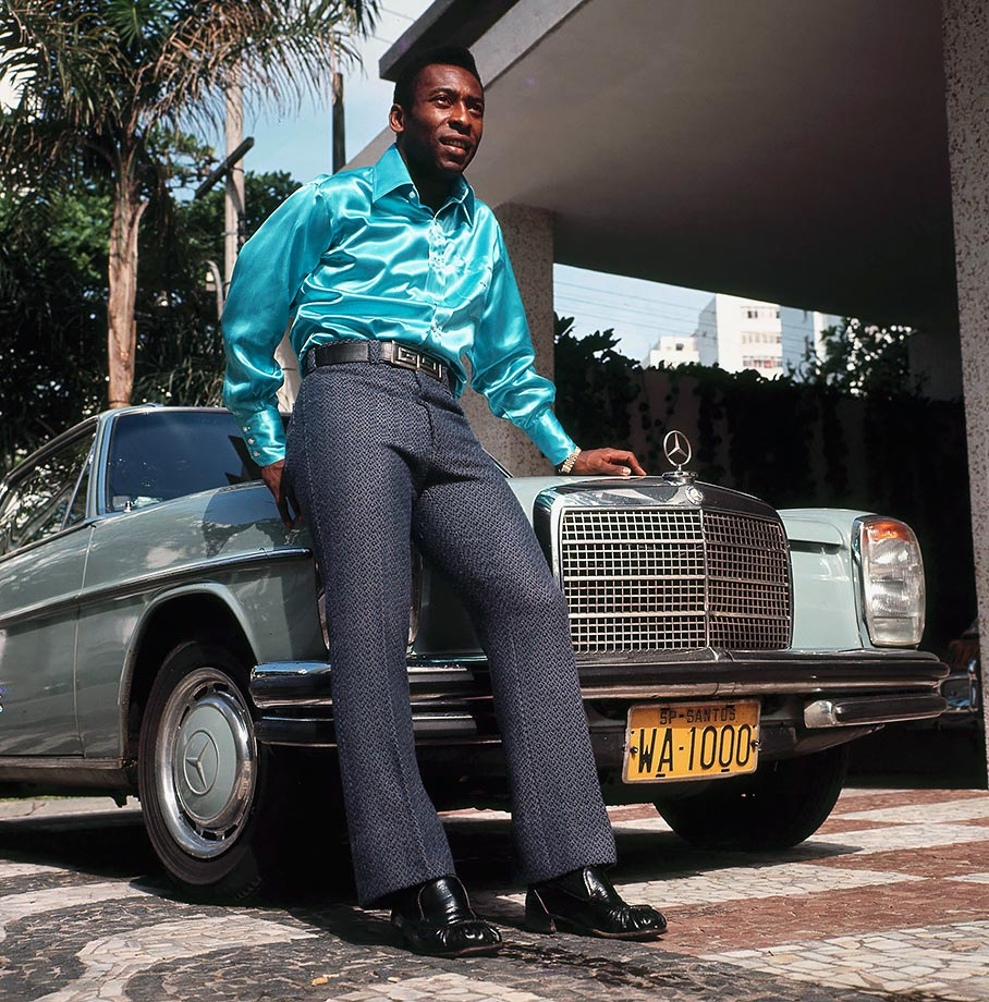 "A stylish Pelé poses in front of a Mercedes-Benz in 1970. His flashy image was fitting, as his on-field play earned him the nickname ""O Rei Pelé,"" meaning ""The King Pelé."""