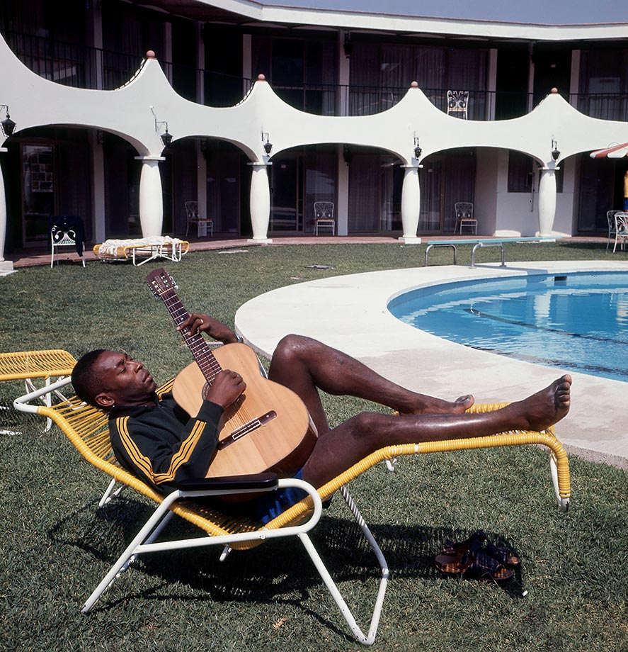 Pelé relaxes by the hotel pool with his guitar after the 1970 World Cup in Mexico. The tournament was music to his ears, as Brazil claimed its third World Cup title.