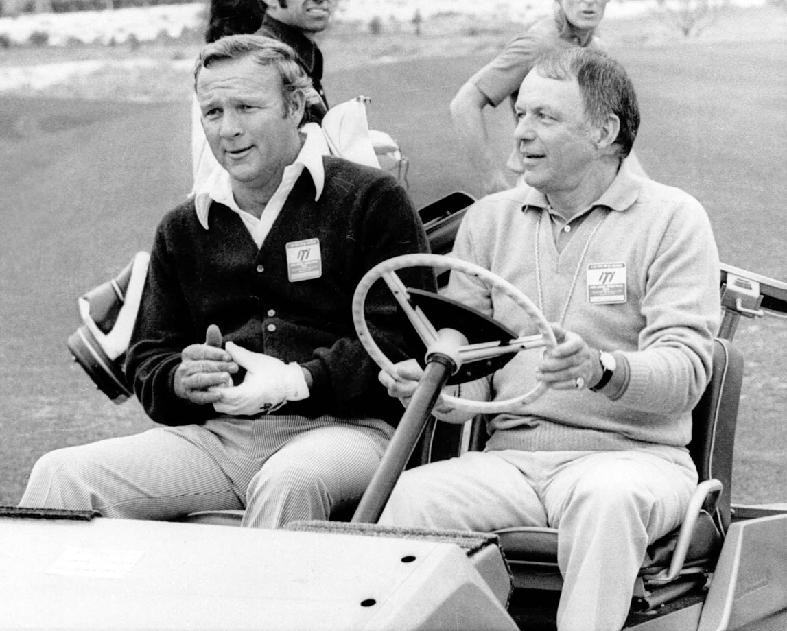 Arnold Palmer, playing in the Tony Lema Scholarship Fund Golf Tournament, was surprised to discover his caddy was none other than Frank Sinatra in Palm Springs, Calif., in Feb. 1972.