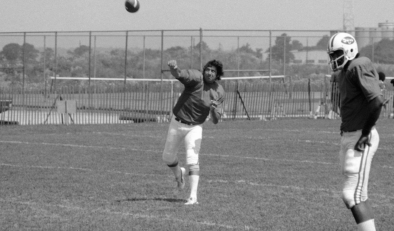 Quarterback Joe Namath demonstrates his throwing form at the Jets' training camp at Hofstra University in Hempstead, N.Y.