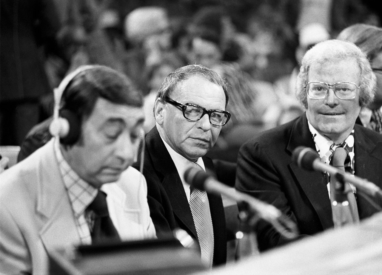 Frank Sinatra sits ringside next to commentator Howard Cosell and Wide World of Sports executive producer Roone Arledge (right) before the Muhammad Ali vs. Ken Norton fight at The Forum in Inglewood, Calif., on Sept. 10, 1973.