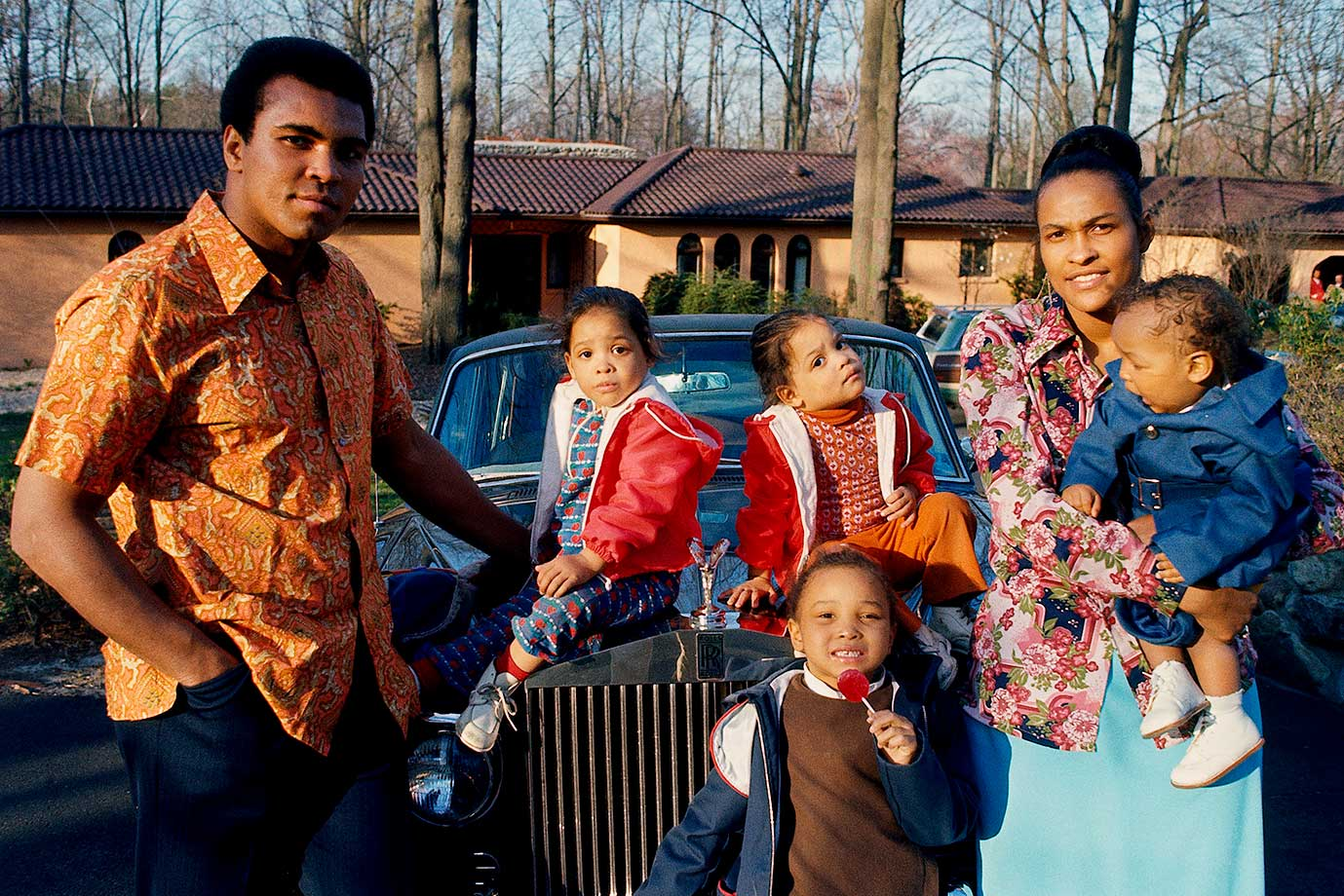 The Ali family standing outside their New Jersey home. To the right of Muhammad Ali are his twin daughters, Jamilllah and Rasheda, daughter Maryum and his wife, Khalilah, holding their son Ibn Muhammad Ali Jr.