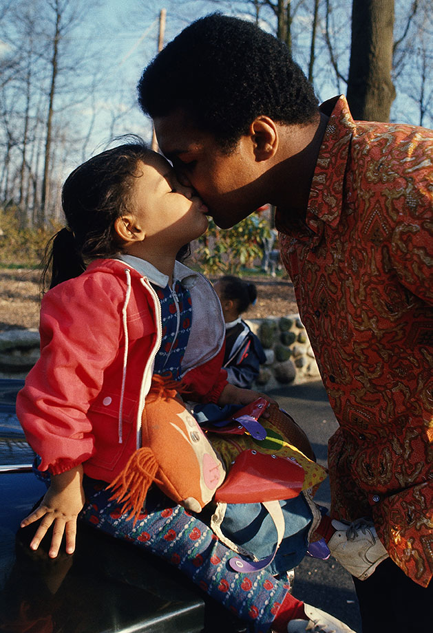 Ali kisses his daughter Jamillah outside of their home following the loss to Norton, just the second defeat of his career.