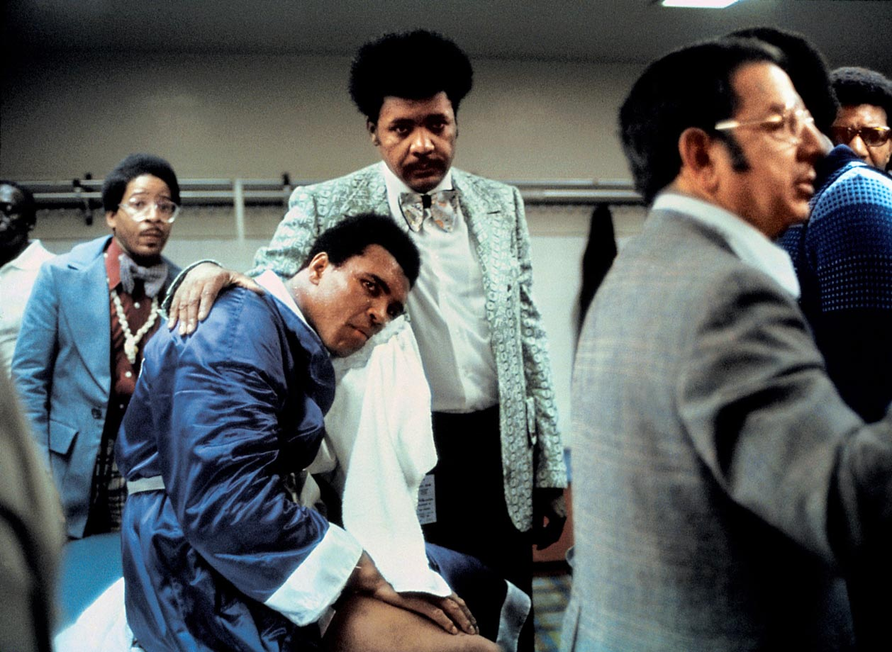 Ali suffered the second loss of his career at the hands of Ken Norton, who broke Ali's jaw during the fight.  Here, Don King comforts Ali as he puts ice on his broken jaw.