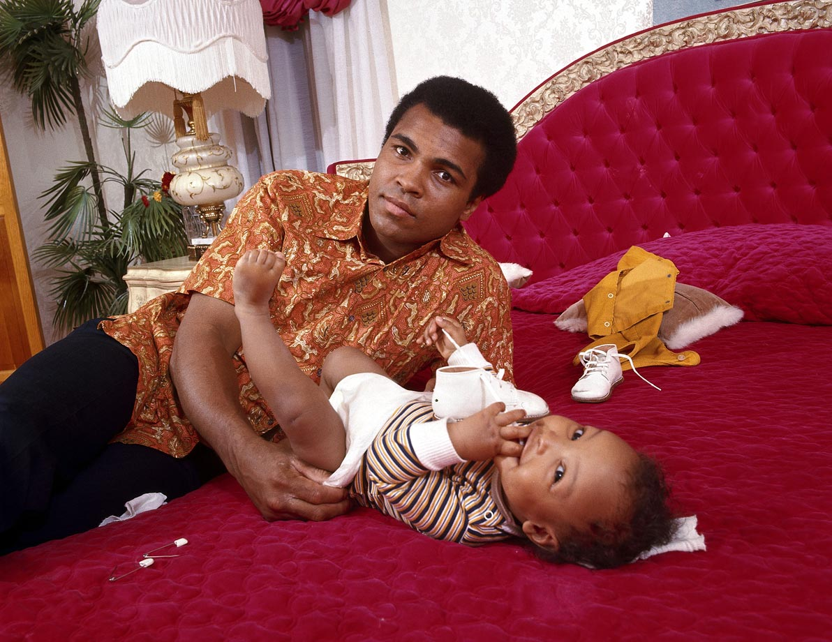 Ali changed the diaper of his son Ibn Muhammad Ali Jr. in his bedroom during a photo shoot at the family's home in April 1973. Ali had suffered a broken jaw less than a month earlier in his fight against Ken Norton.