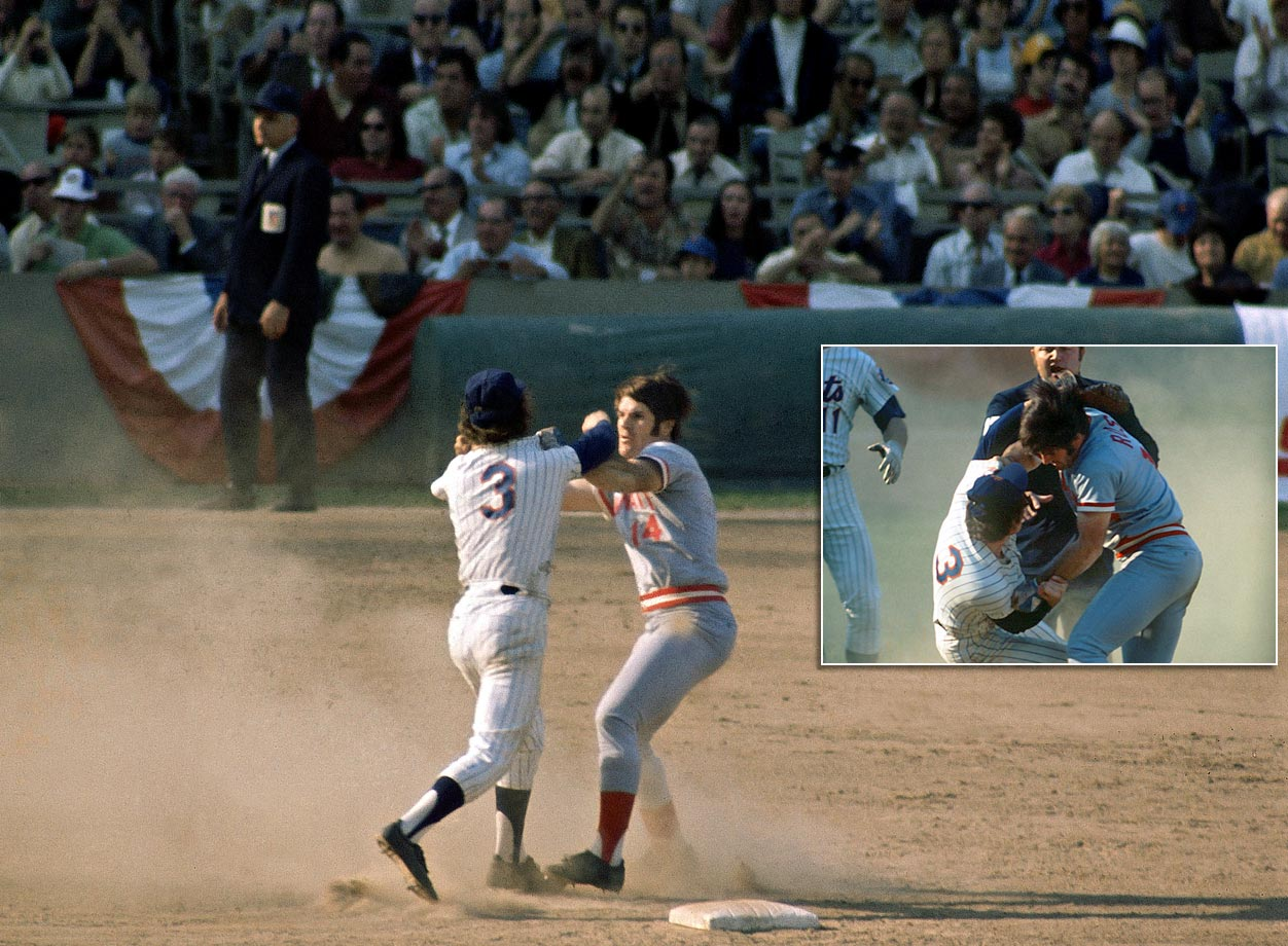 The Mets were routing the Reds 9-2 in Game 3 of the NLCS when Pete Rose slid hard into Mets shortstop Bud Harrelson at second base to try to break up a double play. Rose was upset about comments Harrelson had made in the press and shoved Harrelson, who swung his elbow. Fists started flying as both benches emptied. Pedro Borbon of the Reds and Buzz Capra of the Mets also went mano a mano, with Borbon ending up with the wrong cap — a Mets cap — on his head. When he realized what he had done, he bit a chunk out of it.