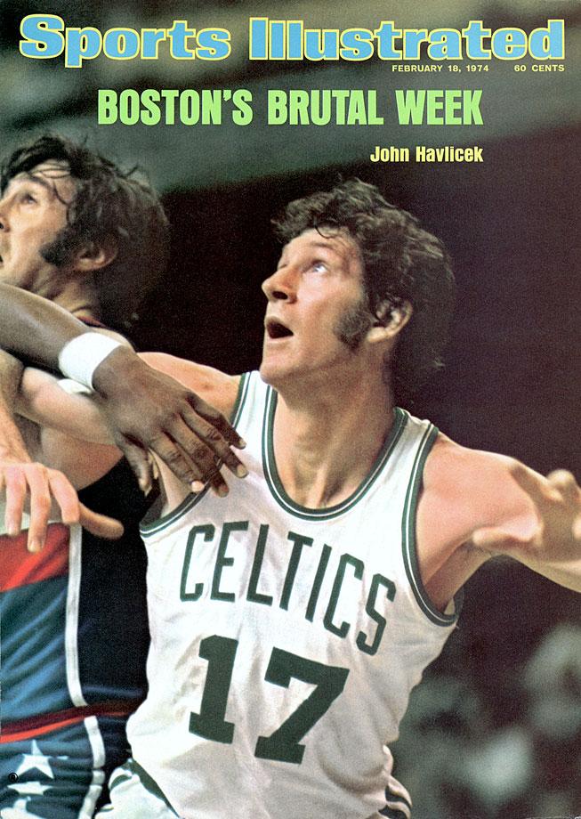 John Havlicek battles for position during a Celtics game against the Capital Bullets at Boston Garden.