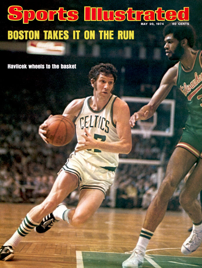 John Havlicek drives to the basket against Kareem Abdul-Jabbar during the NBA Finals between the Boston Celtics and Milwaukee Bucks.  The Celtics won the series in seven games for their 12th championship.