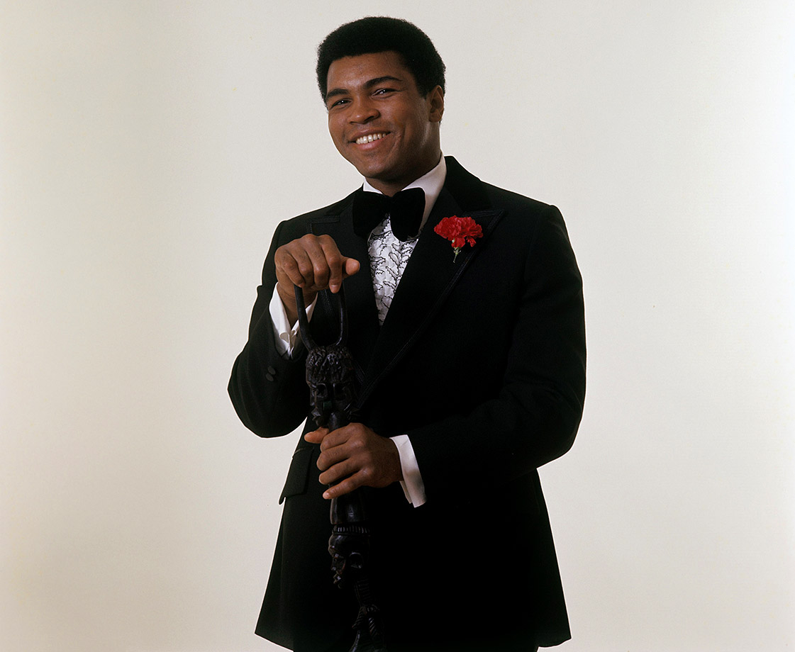 This time Ali wears a tuxedo, but keeps the walking stick, during the November photo shoot for Sports Illustrated's Sportsman of the Year.