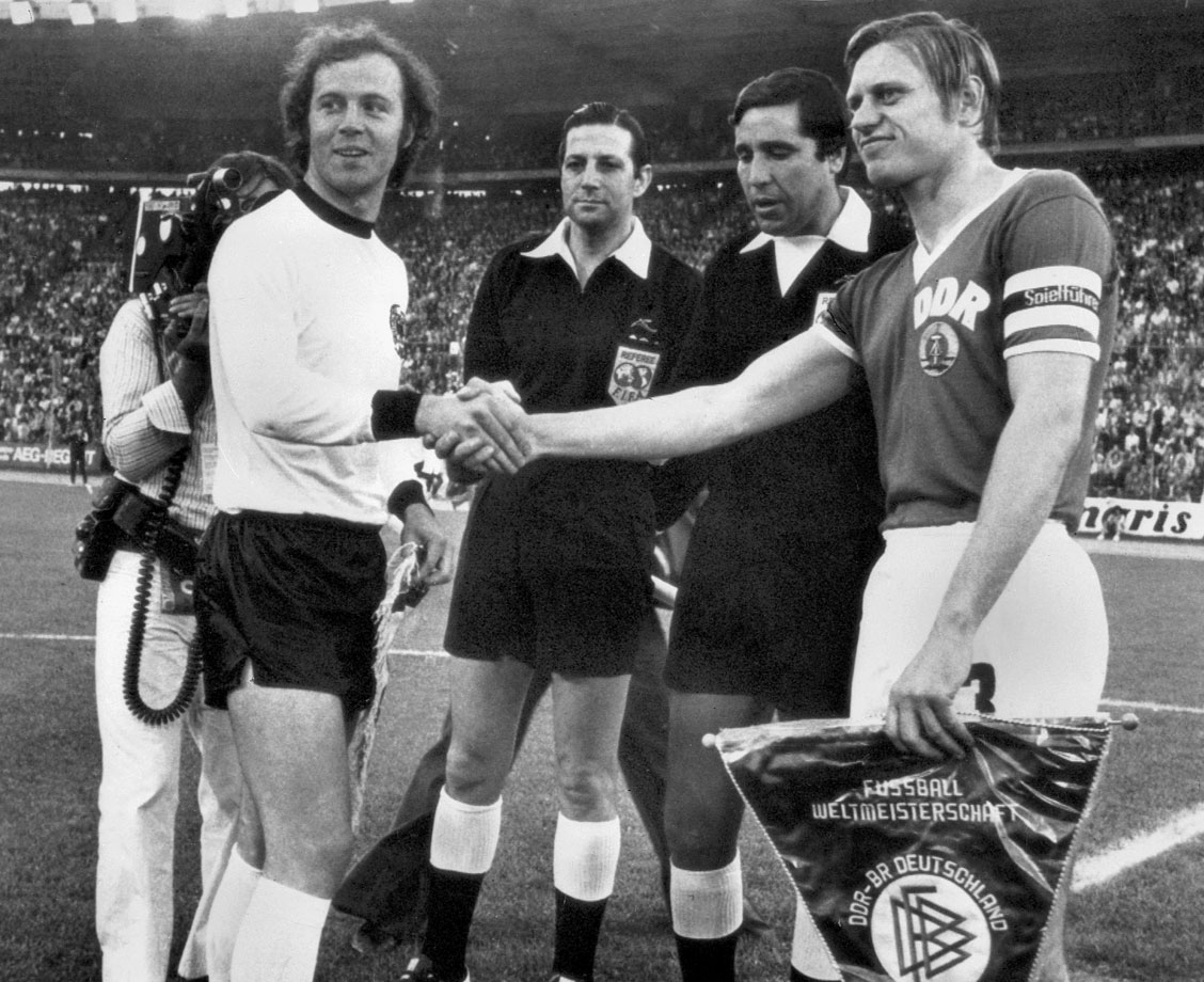 West Germany's Franz Beckenbauer performs the customary captain's pregame handshake with East Germany's Bernd Brausch, a historic moment that brought together the two separated (since rejoined) parts of Germany ahead of their first-round match in the 1974 World Cup.