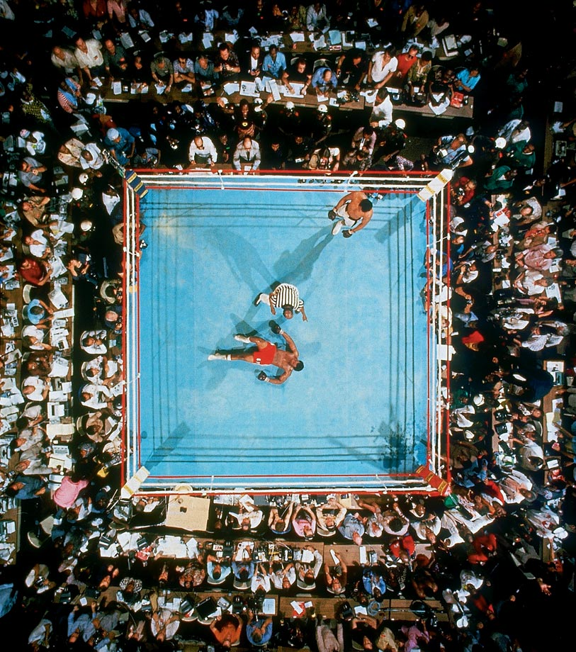 Employing his never-before-seen rope-a-dope strategy, even as his corner pleaded with him to move and dance, Ali let Foreman punch himself out, then came off the ropes firing big shots of his own. In a stunning finish he put Big George down for good in the eighth round. Here, the soon-to-be-ex-champ stares at the ceiling (and Leifer's lens) as referee Zack Clayton counts him out and Ali, having once again shocked the world, stands calmly by.