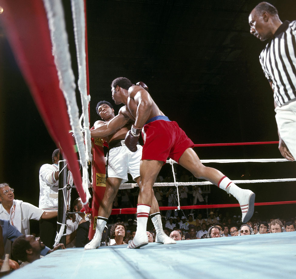 "By the start of the second round, Muhammad Ali's game plan was beginning to unfold: He began lying on the ropes, where he absorbed George Foreman's punches without any counterattack. Ali latter coined his style ""rope-a-dope."""