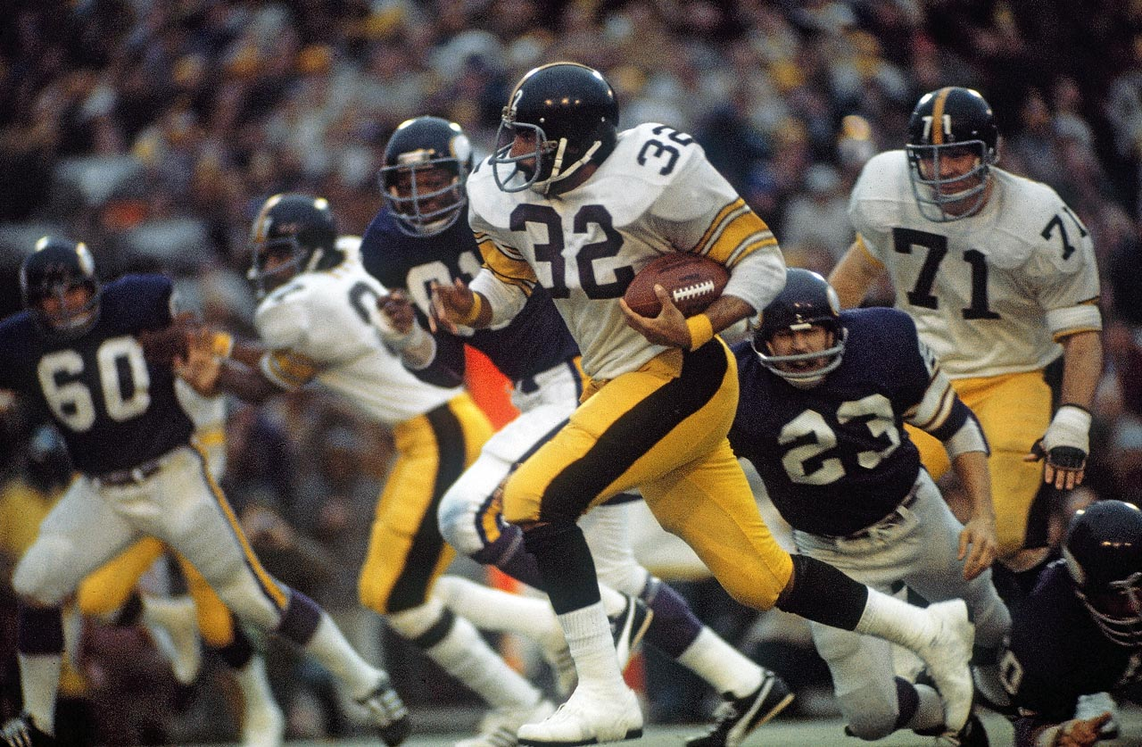 Pittsburgh Steelers fullback Franco Harris sprints away from the Minnesota Vikings defense. Harris set a Super Bowl record with 158 rushing yards as he earned Super Bowl MVP honors.