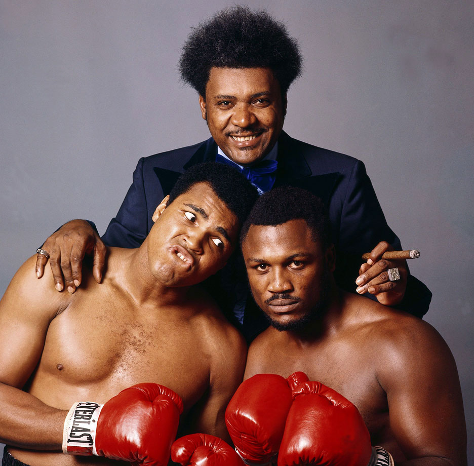 "Along with Don King and Joe Frazier, Ali sat for a portrait leading up to the Thrilla in Manila. Ali verbally abused Frazier during the buildup to the fight, telling the media that ""it will be a killa and a thrilla and a chilla when I get the gorilla in Manila."""