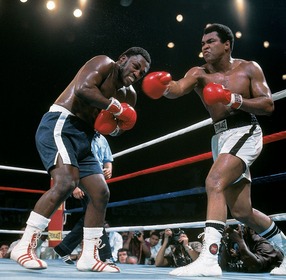 The third fight between Ali and Frazier, Ali won the bruising battle between the two powerful punching heavyweights when Frazier's trainer, Eddie Futch, stopped the fight before the 15th round.