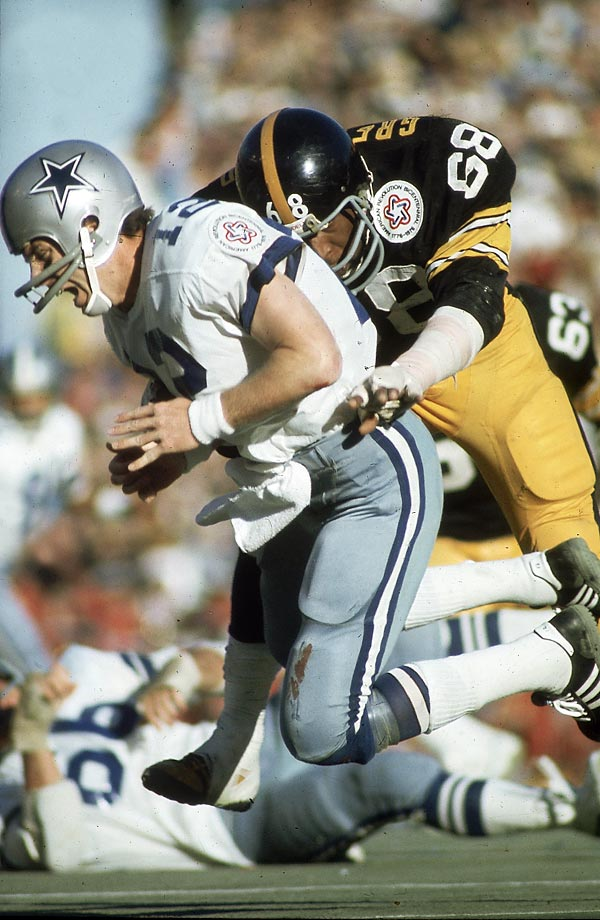 Pittsburgh Steelers defensive end L.C. Greenwood takes down Dallas Cowboys quarterback Roger Staubach. The Steelers' intimidating defense forced Staubach into three interceptions and sacked him seven times during Pittsburgh's 21-17 win.