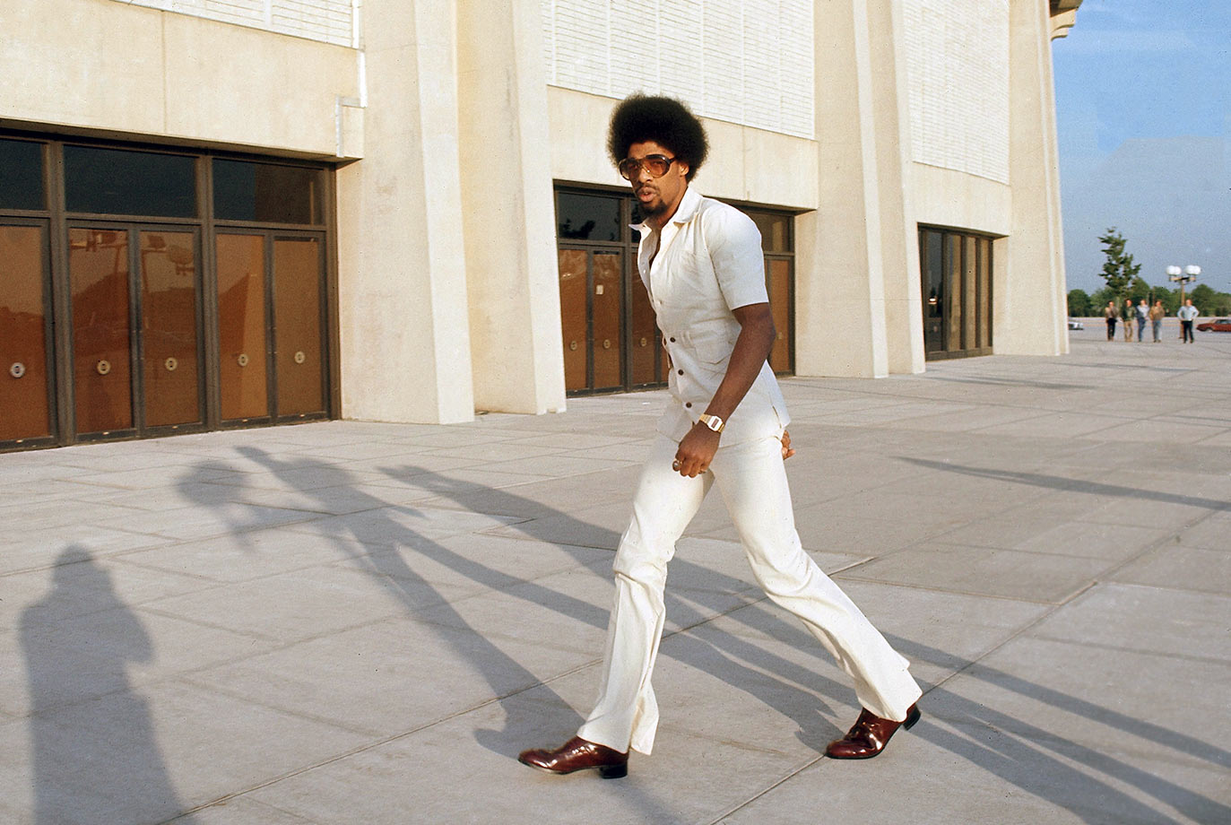 Dr. J shows off his '70s style as he enters the Nassau Coliseum before the Nets' Game 4 of the ABA Championship against the Denver Nuggets.
