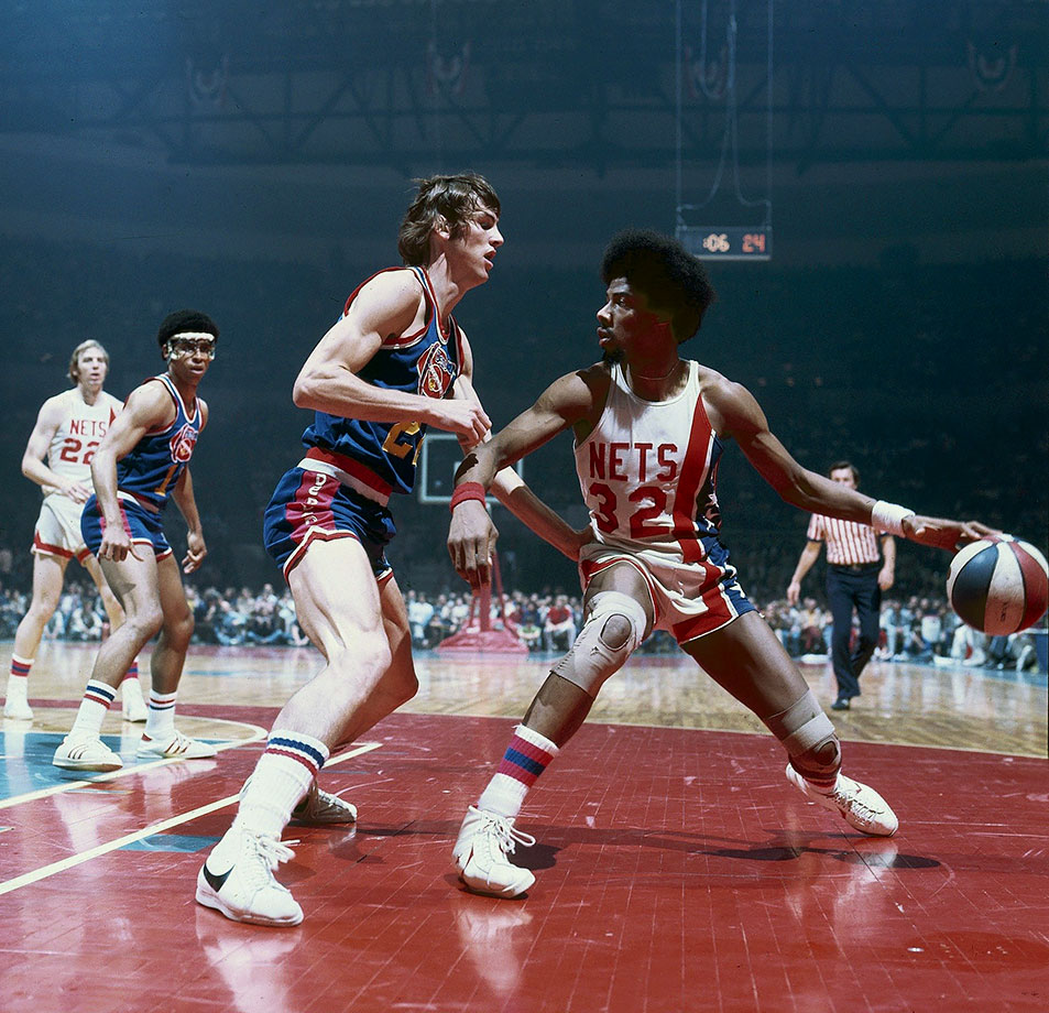 Dr. J posts up the Denver Nuggets Gus Gerard during a 1976 game.