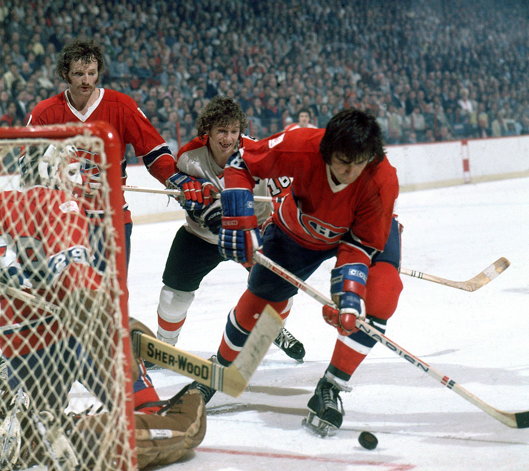 Serge Savard of the Canadiens outraced Philadelphia's Bobby Clarke to the puck while Montreal's Larry Robinson and Ken Dryden looked on in Game 3. Savard needn't have hurried. Dryden was at the top of his game, leading the league with a postseason 1.92 GAA while going 12-1 to backstop the Habs to the 19th championship in the franchise's storied history.