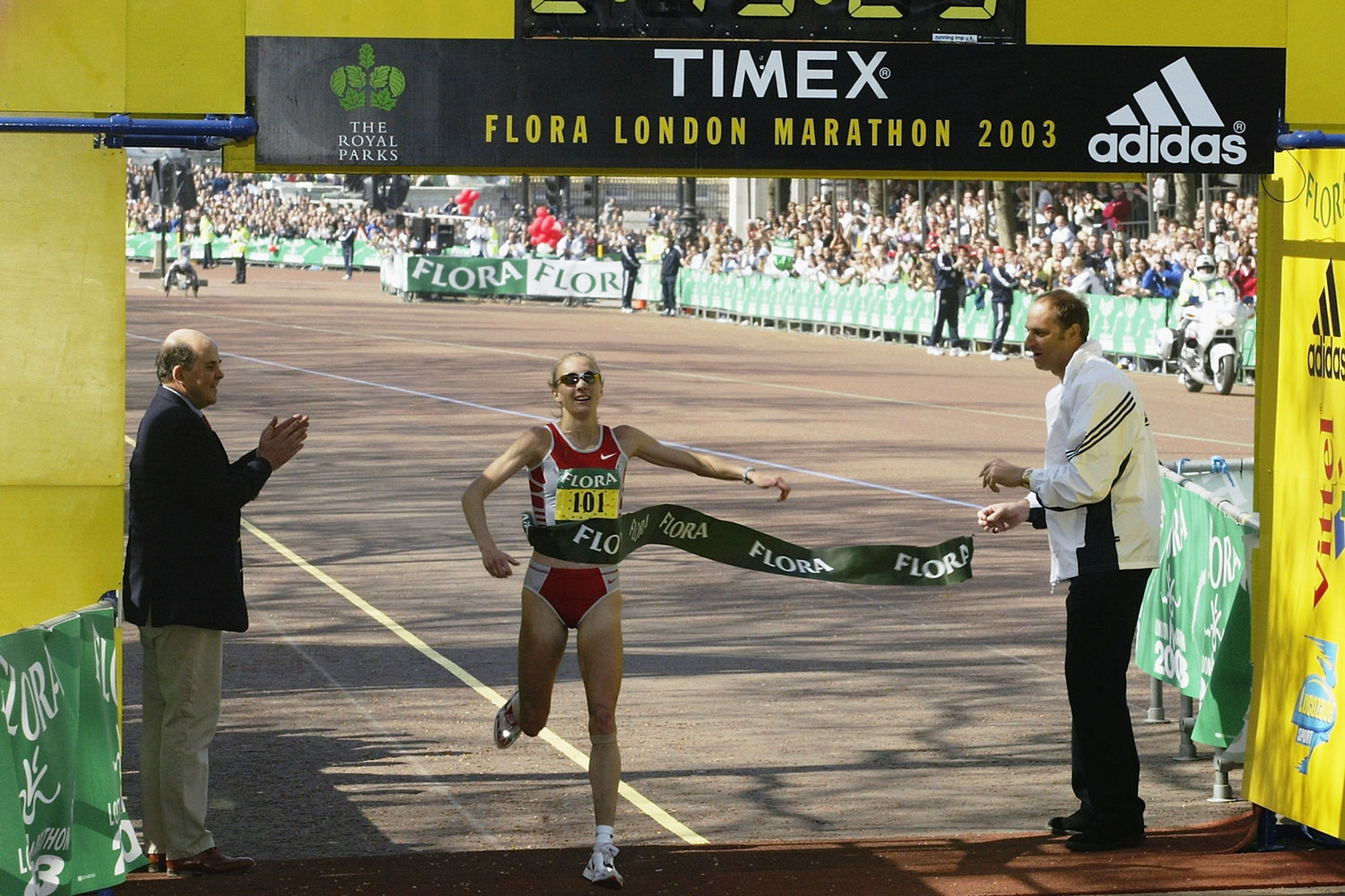 Paula Radcliffe crosses the finish line to win the 2003 Flora London Marathon at the Mall in London, England.