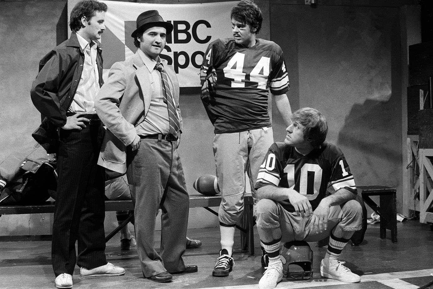 "Bill Murray, John Belushi and Dan Aykroyd act alongside Minnesota Vikings quarterback Fran Tarkenton during SNL's ""Team Saturday Night"" skit on Jan. 29, 1977 in New York City."