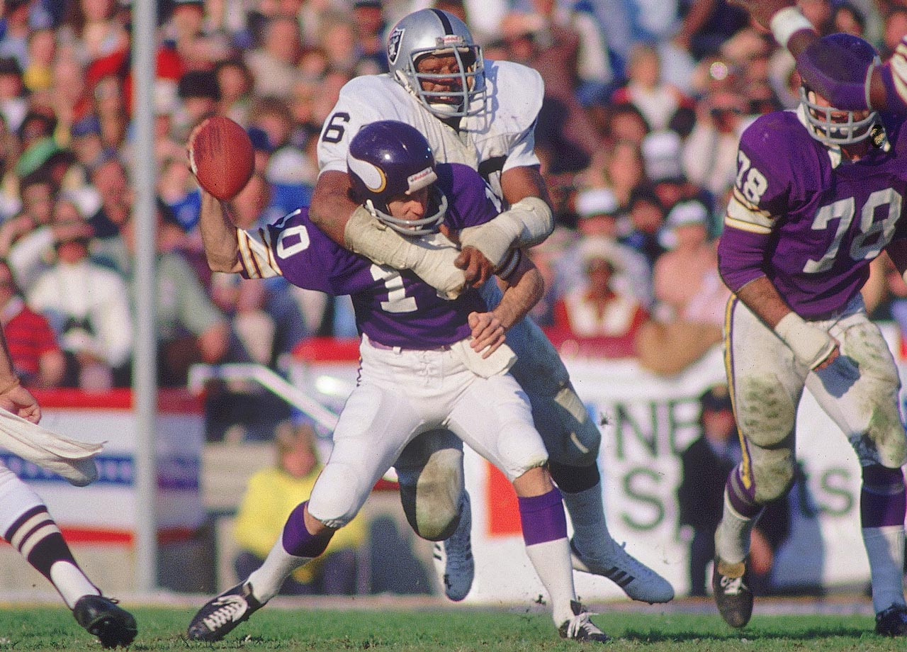 Oakland Raiders defensive end Otis Sistrunk sacks Fran Tarkenton, forcing the Minnesota Vikings quarterback to fumble. Oakland's offense had a field day with the Vikings, setting a Super Bowl record with 429 yards of offense.
