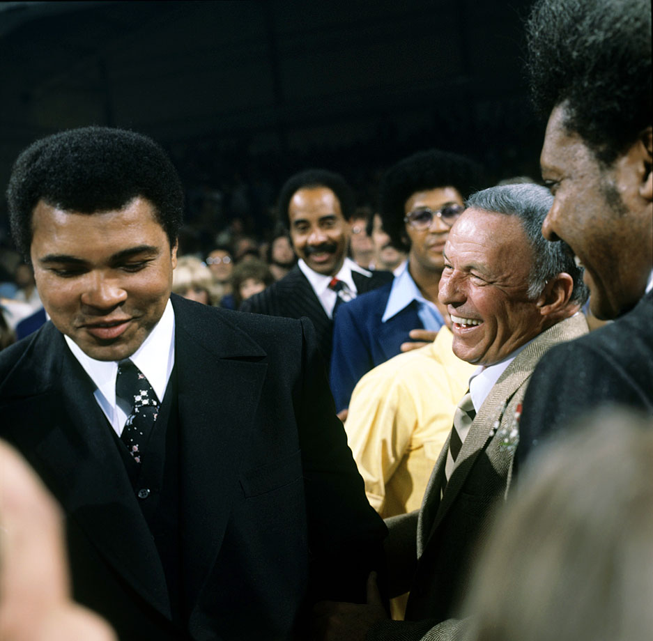 Frank Sinatra shares a laugh with Muhammad Ali as promoter Don King looks on before the Ken Norton vs. Jimmy Young fight at the Sports Pavilion of Caesars Palace in Las Vegas on Nov. 5, 1977.
