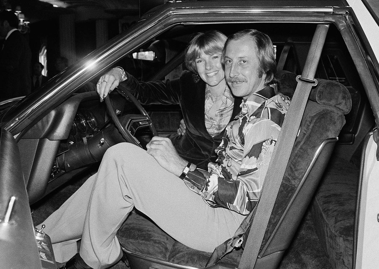 Oakland Raiders wide receiver Fred Biletnikoff and wife Jennifer sit in a new car presented to him for being the most valuable player after the Raiders defeated the Minnesota Vikings 32-14.