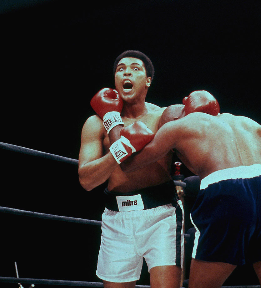 Ali makes a face during his fight with Earnie Shavers in 1977 at Madison Square Garden. Hurt badly by Shavers in the second round, Ali rebounded and outboxed Shavers throughout to build a lead on points before Shavers came on again in the later rounds. Seemingly exhausted going into the 15th and final round, Ali remained victorious by producing a closing flurry that left Shavers wobbling at the bell and the Garden crowd once again in delirium over his Ali magic.