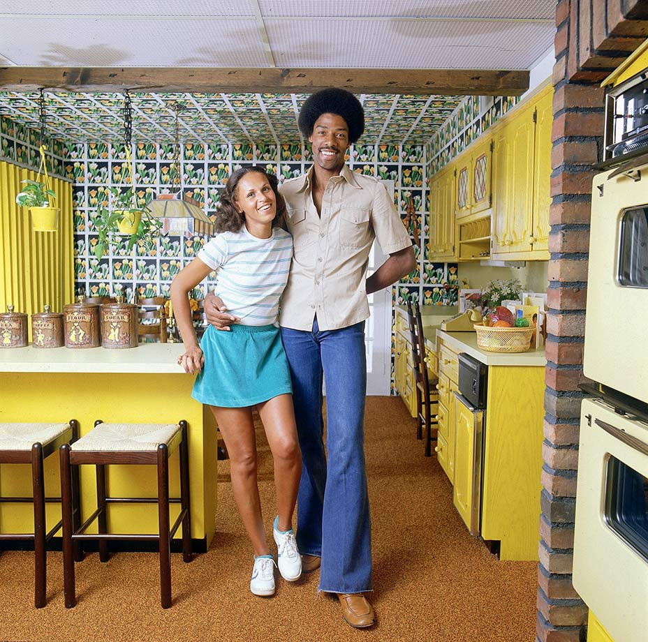 Dr. J with first wife Turquoise in their kitchen. They were married 31 years.
