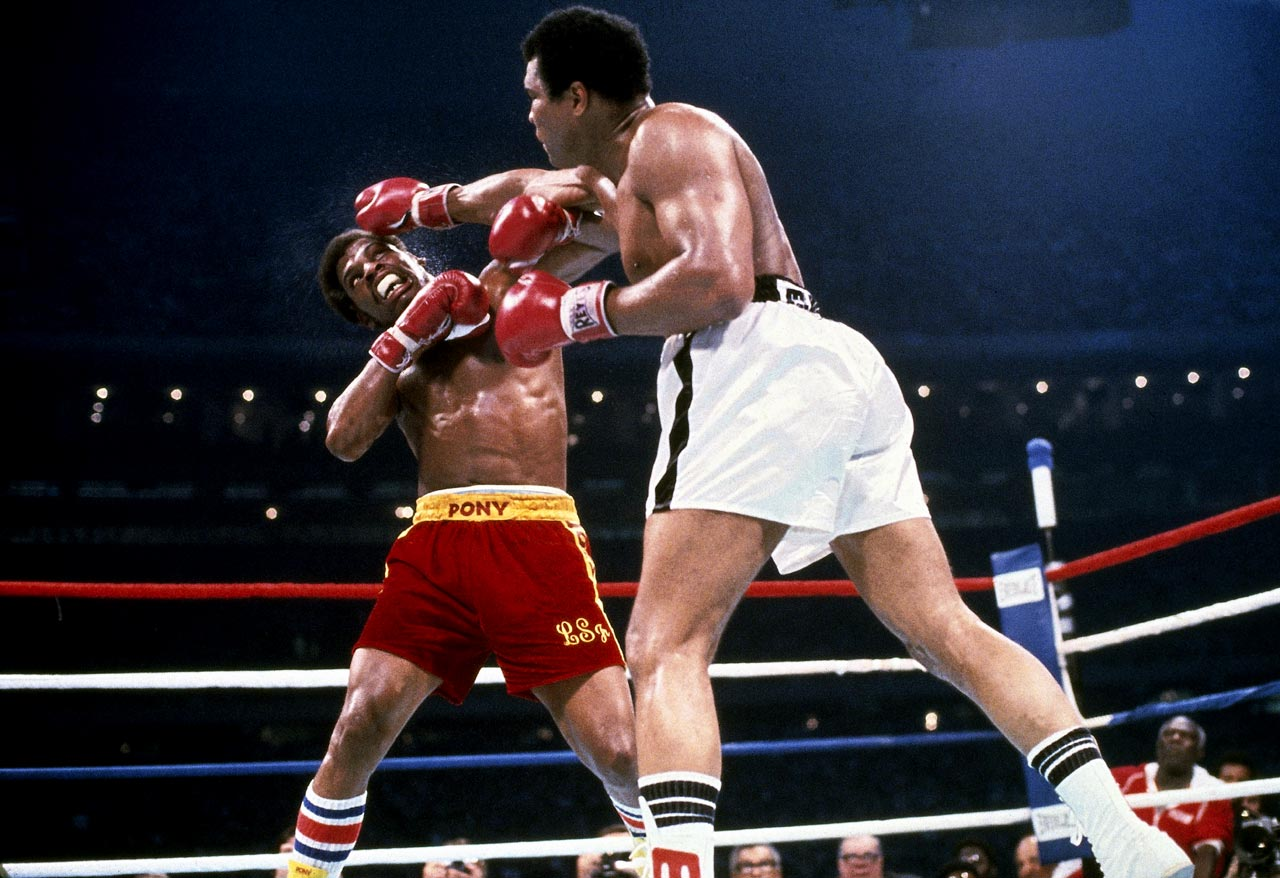 Ali lands a straight right hand to the head of Spinks in the rematch of their title bout in 1978. Ali won on a 15 round decision.
