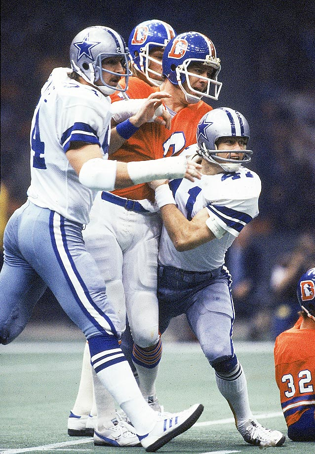 Randy White (54) and Charlie Waters (41) ease up after having pressured Denver quarterback Craig Morton. White shared MVP honors with teammate Harvey Martin, which marked the first time a defensive lineman was named Super Bowl MVP.
