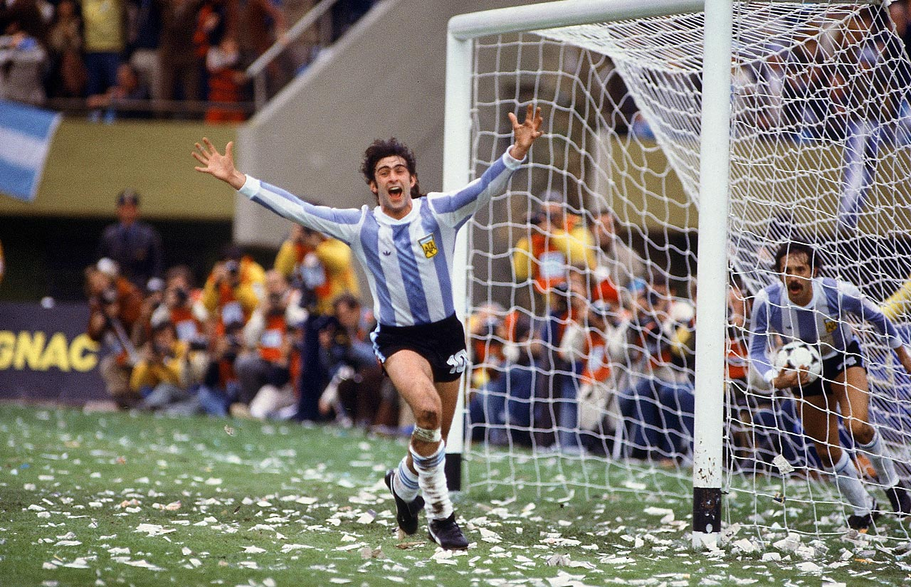 Mario Kempes runs off to celebrate his game-clinching goal in extra time, which helped lift Argentina to a 3-1 victory of the Netherlands in the 1978 World Cup final.