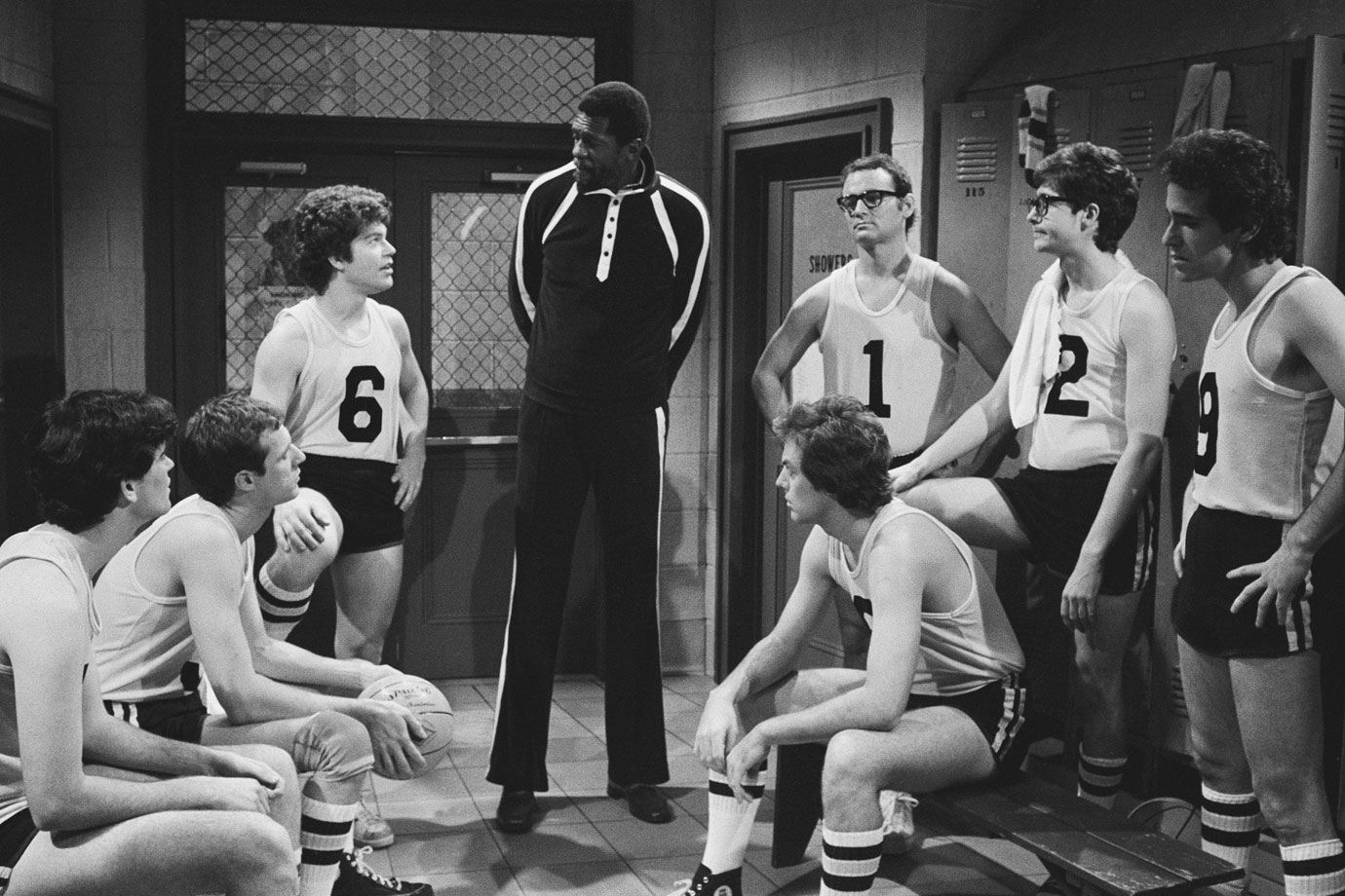 "Bill Murray appears with Al Franken and Bill Russell during SNL's ""The Black Shadow"" skit on Nov. 3, 1979 in New York City."