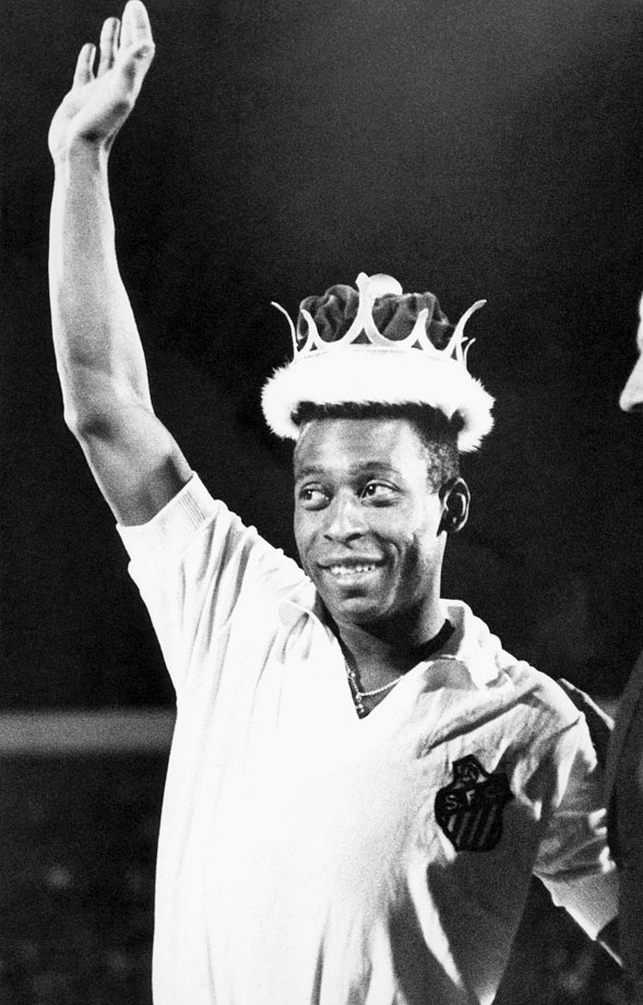 "Pelé smiles and waves to fans after being crowned ""King of Soccerdom,"" a gift from America Club of Mexico on Feb. 4, 1979. The crown in gold and silver was worth $13,000."
