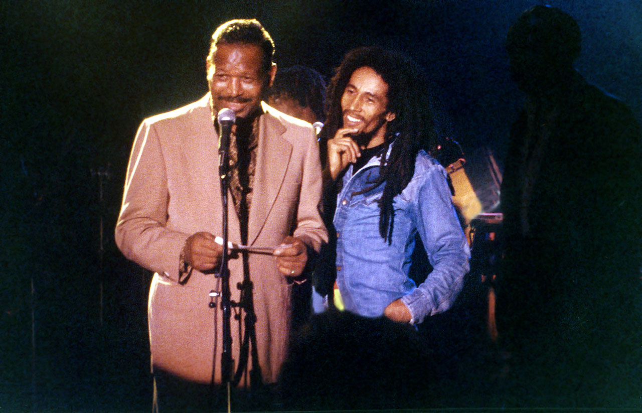 Bob Marley joins former Heavyweight Boxing Champion Sugar Ray Robinson on stage during a benefit concert for the Sugar Ray Robinson Youth Foundation on Nov. 27, 1979, in West Hollywood, Calif.