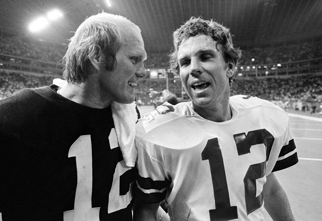 Terry Bradshaw chats with Cowboys quarterback Roger Staubach after a preseason game in Irving, Texas, in Aug. 1979.