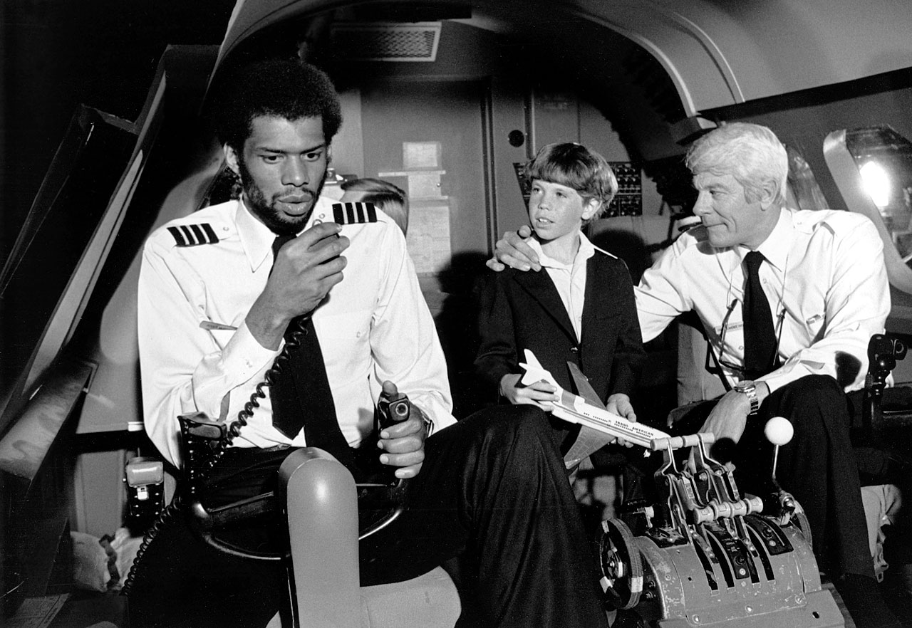 "with actors Rossie Harris (Joey) and Peter Graves (Captain Oveur) in the movie ""Airplane!"""