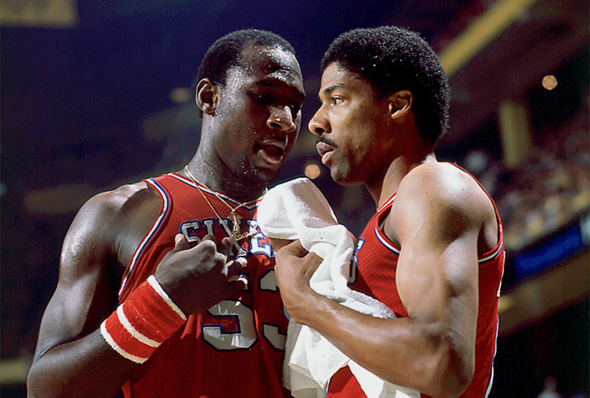 Dr J. confers with teammate Darryl Dawkins during the 1980 playoffs.