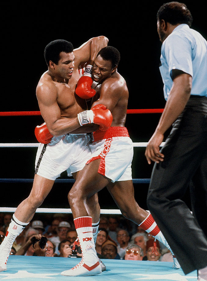 Ali grapples with Holmes during their bout in 1980. Trainer Angelo Dundee stopped the fight in the 11th round, marking the fight as Ali's only career loss by knockout.