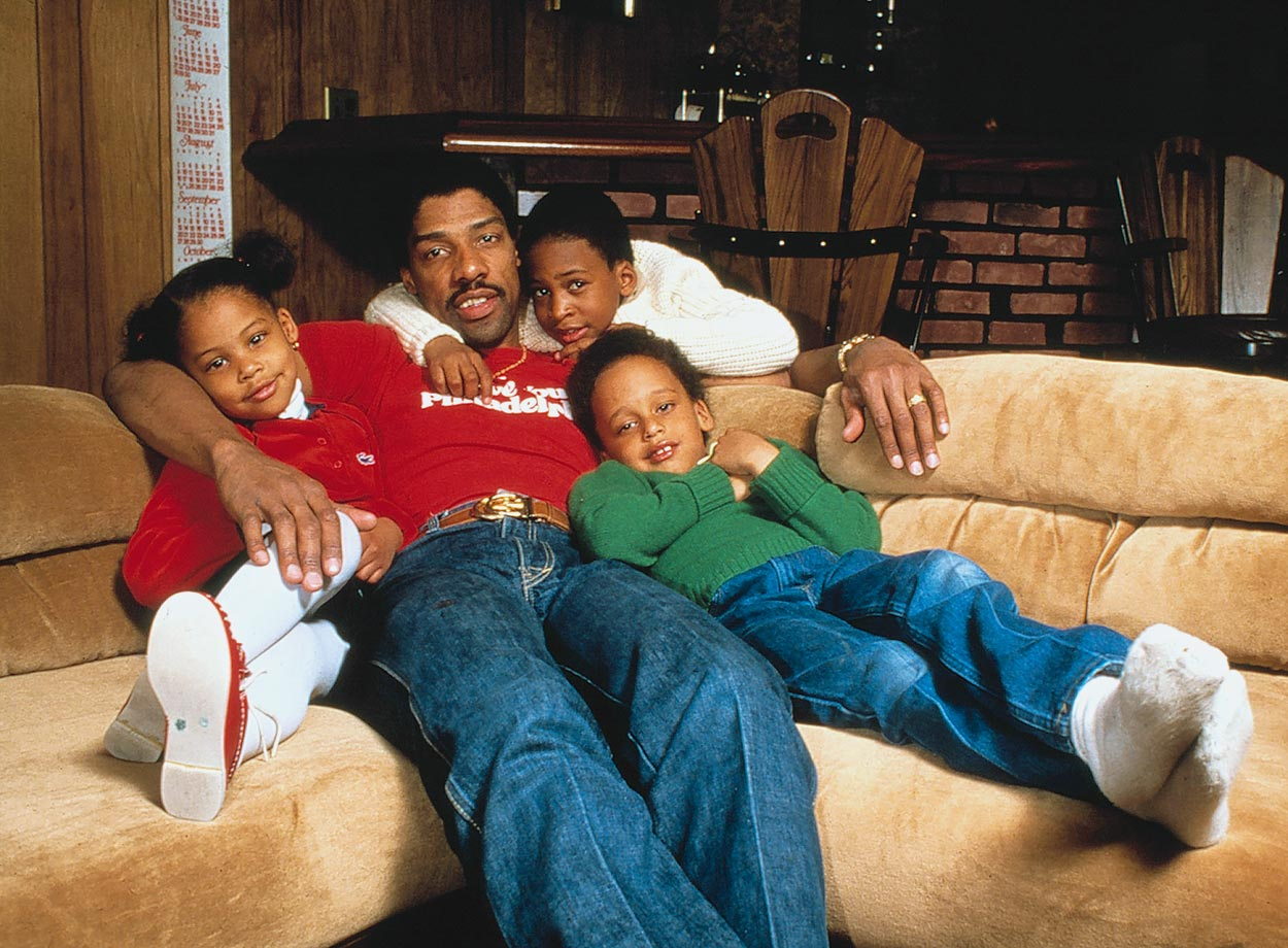 Dr. J poses with three of his children—Jazmin, Julius III and Cheo.
